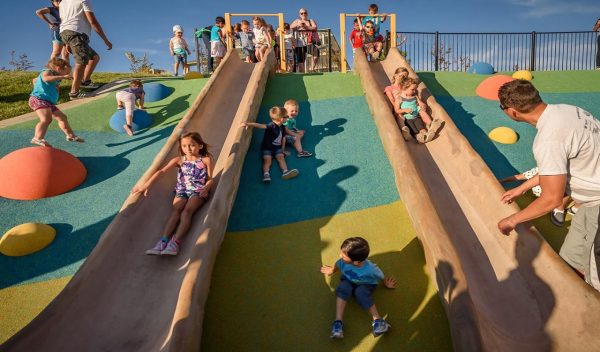 Children on outdoor slides and play area