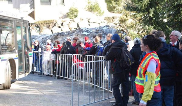 Event attendees waiting for the bus at the Winter Olympics events in Whistler, British Columbia.