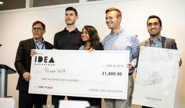 winning team, PowerWalk receive check