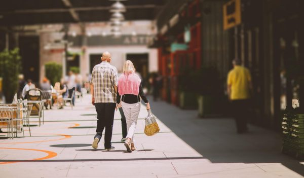 Older couple walking on a street