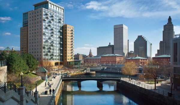 A view of the Woonasquatucket  river and downtown buildings