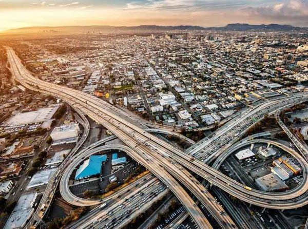 Helicopter view of highway interchange in Los Angeles, California.