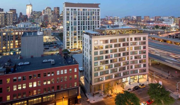 Troy Boston is 400,000 square feet and includes a rooftop garden and enclosed courtyard.