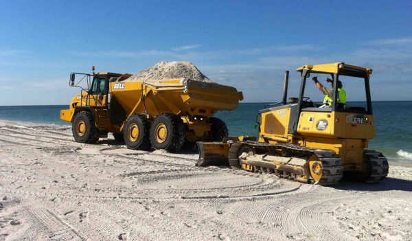 Equipment bringing sand to beach in Naples, Florida.