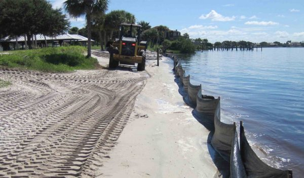 Equipment spreading sand for re-nourishment at Port Charlotte Beach