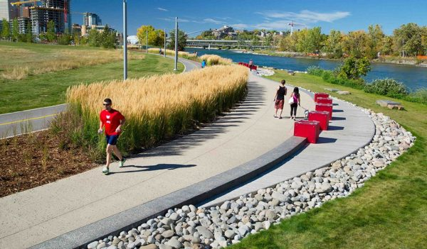 Runner and walkers on the Calgary RiverWalk multiuse trail