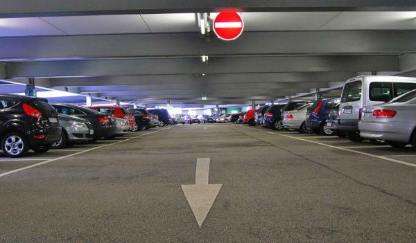 Rows of cars parked in an above ground covered parkade.