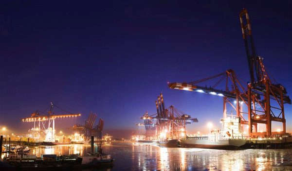 cargo cranes on site at night