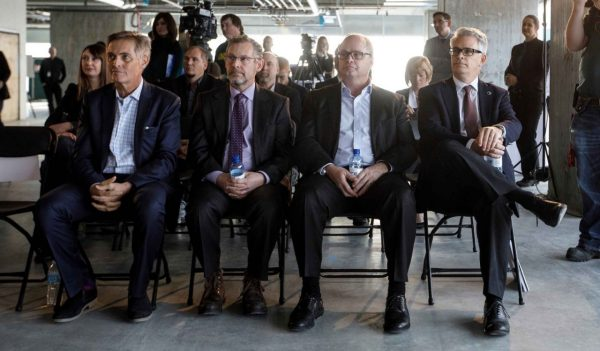 Glen Scott, president of Katz Group Real Estate; Keith Shillington, Stantec senior vice president; Dan Lefaivre, Stantec executive vice president and chief financial officer; and Gord Johnston, Stantec president and CEO, sitting next to one another.