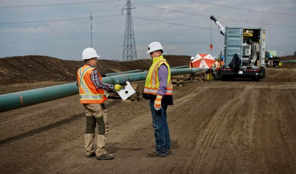 Workers on the site of a pipeline