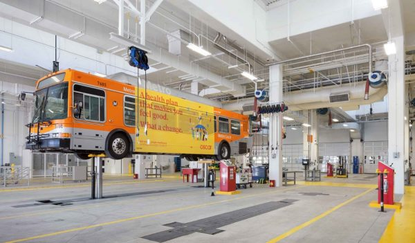 Bus on a lift at LA Metro Division 13 Bus Operations & Maintenance Facility, Los Angeles, California.