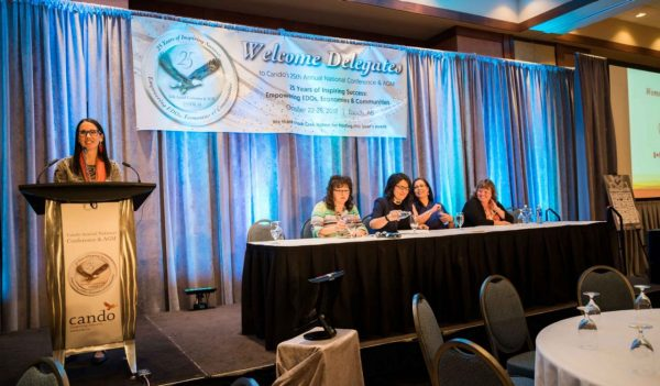 Denise Pothier moderating the Indigenous Women in Business panel at the Cando conference.