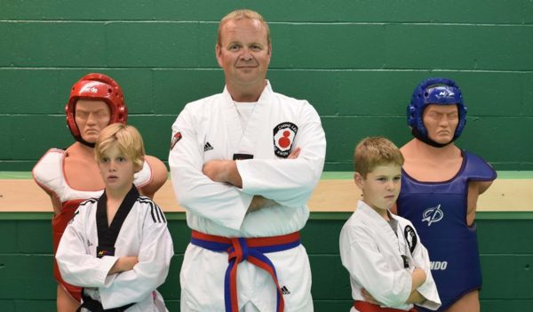 Karate instructor and his students