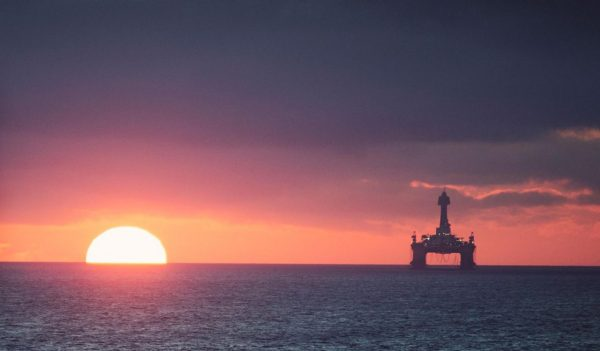 Sunset near oil rig