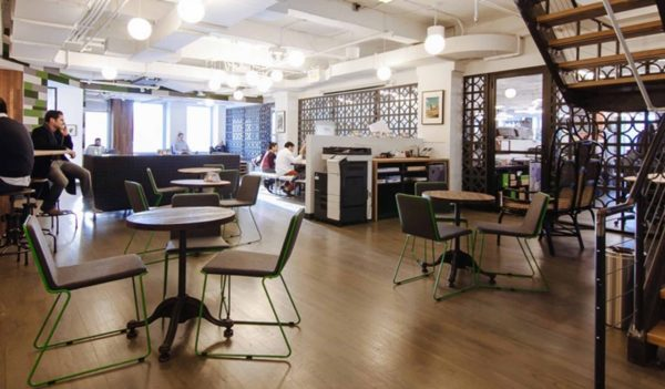 WeWork, open space with cafe tables