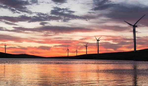 windmills and lake and sunset in ireland