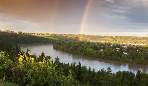 Rainbow over North Saskatchewan River. Edmonton, Alberta, Canada.