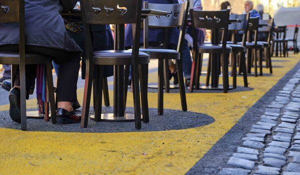 CABA, Buenos Aires / Argentina; Sept 19, 2020: Tables and chairs in the street, in circles that mark the social distance needed to prevent the spread of the coronavirus, during the covid19 pandemic