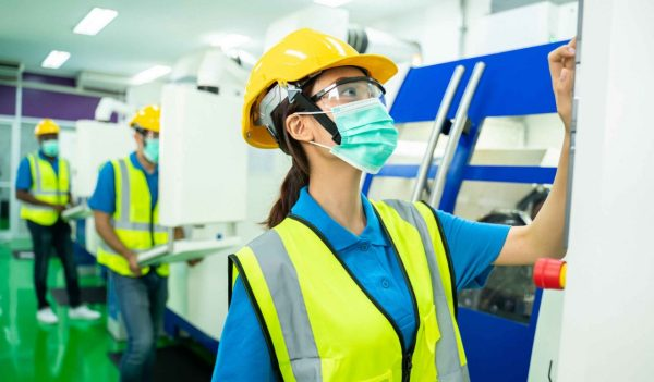 Portrait of technician or worker or engineer woman with hygienic mask stand with confident action in workplace during concern about covid 2019 pandemic in people affect industrial business.