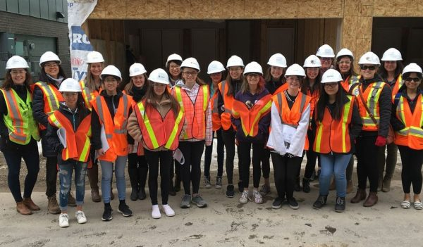 A group of girls at a construction site