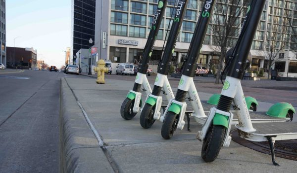 Scooters parked on the sidewalk