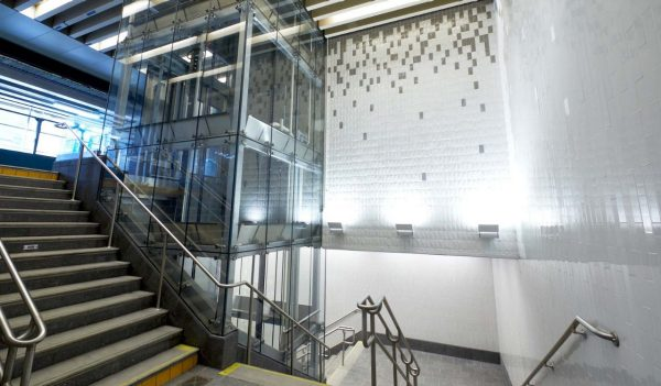 Elevator and stairs in the lobby to transit