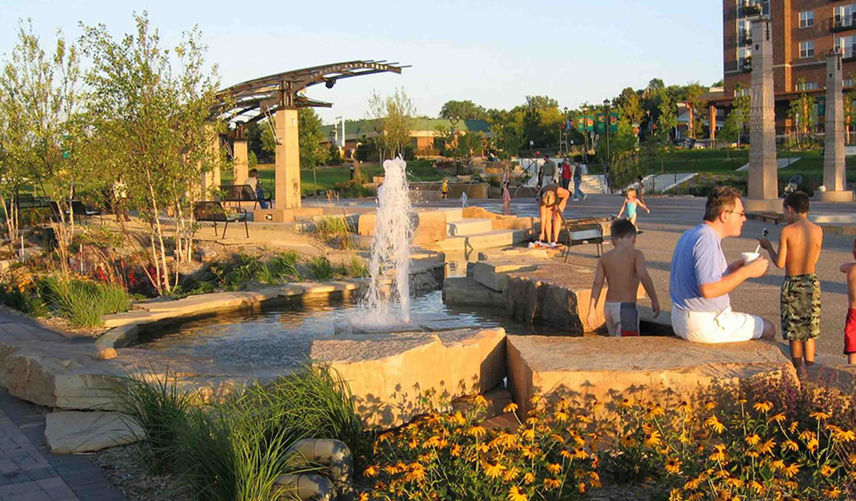Open park area with water feature and seating areas